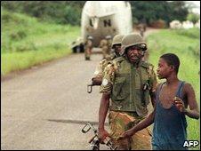 UN troops confront a Sierra Leone militiaman, 2000