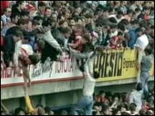 People being lifted over the stands at Hillsborough
