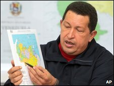 President Chavez points to a map of the Venezuelan and Colombian border during a TV appearance, 28 July 2009