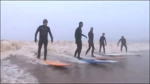 Surfers riding the Severn Bore