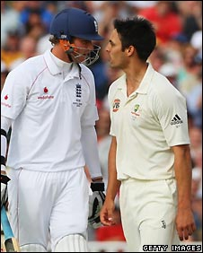 Stuart Broad (left) exchanges words with Mitchell Johnson