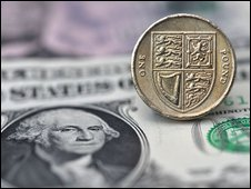 Pound coin rests on dollar note