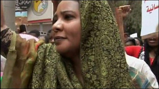 Lubna Ahmed Hussein joins supporters on the streets of Khartoum