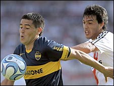 Boca Juniors midfielder Juan Roman Riquelme (left) vies for the ball with River Plate defender Gustavo Cabral during a Superclasico derby between the two Argentine clubs in 2008