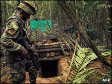 Colombian soldier stands at enterance to bunker used by Farc rebels