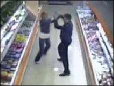 Screen grab of Denis Yevsyukov, right, struggling with a woman in a Moscow supermarket, 27 April 2009