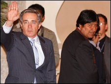 "Colombia""s President Alvaro Uribe, left, waves as Bolivia's President Evo Morales looks on at the presidential palace"