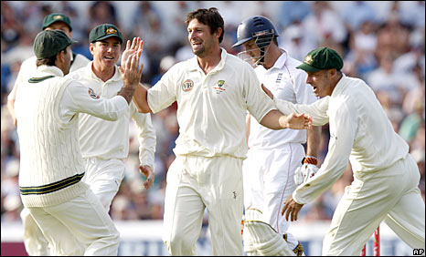 Australia celebrate the wicket of Andrew Strauss
