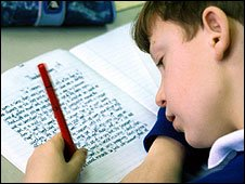 Boy writing in book