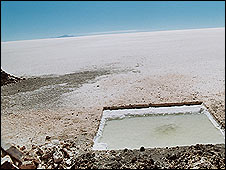Hole cut in salt flats to obtain brine