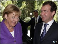 Dmitry Medvedev greets Angela Merkel in Sochi, Russia, 14 August 2009
