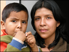 Margarita Ramirez and her son, Jair, outside their new seismic-resistant home