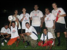 Charles Musana and Paul Watson with a team of Pohnpei players in Spurs shirts