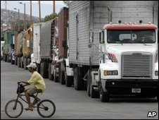 Trucks wait to cross from Colombia into Venezuela in file photo from July 2009