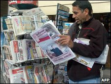 A man reads a paper in Tunis, file image