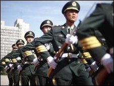 Chinese soldiers march during a welcome ceremony at the PLA headquarters in Beijing
