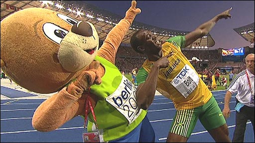 Usain Bolt celebrates with Berlino the Bear