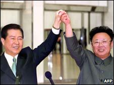 North Korean leader Kim Jong-Il (R) and South Korean President Kim Dae-Jung joining hands during a historic summit in the North Korean capital city of Pyongyang