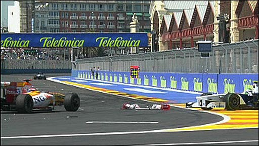 Fernando Alonso's Renault and Nick Heidfeld's BMW just after colliding