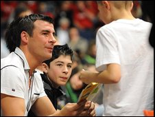 Joe Calzaghe signs an autograph at a Calzaghe Promotions event