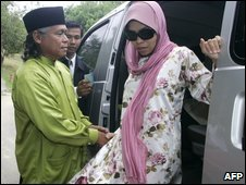 Kartika Sari Dewi Shukarnor is greeted by her father at their family home in Karai, Malaysia, after her caning is delayed - 24 August 2009