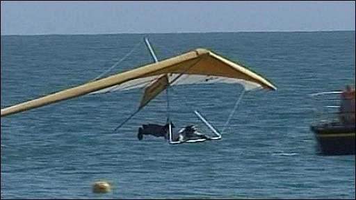 Man flies across water
