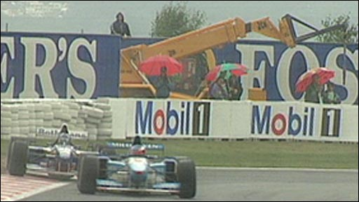 Michael Schumacher overtakes Damon Hill