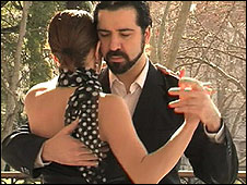 Young couple dancing the tango