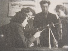 Nina (left) giving training in small arms use