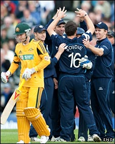 Scotland celebrate taking the wicket of Michael Clarke