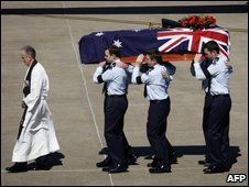 Chaplain Gary Whelband (L) leading the bearer party carrying the casket of returned serviceman Pilot Officer Robert Charles Carver - 31 August 2009