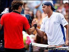 Roger Federer and Devin Britton