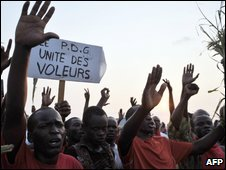 "Supporters of an opposition candidate Pierre Mamboundou in Gabon""s presidential elections gather near the offices of the electoral commission"