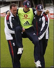 Joe Denly is carried off at The Oval