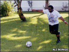 Ali Bongo kicking a football