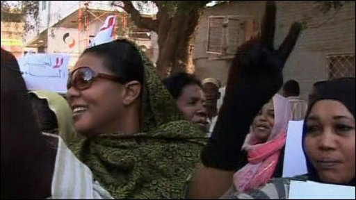 Lubna Ahmed al-Hussein and supporters