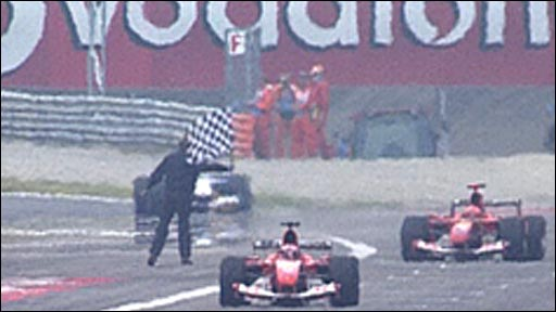 Rubens Barrichello leads home a Ferrari one-two