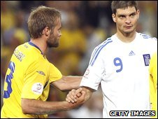 Sweden's Olof Melberg (left) shakes hands