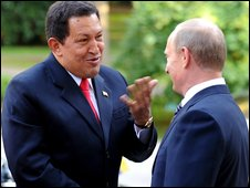 Venezuelan President Hugo Chavez (L) and Russian Premier Vladimir Putin
