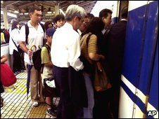 Rush hour crowd at Tokyo railway station - file picture