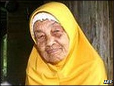 Wook Kundor sits outside her house in Malaysia's northern Kuala Terengganu state