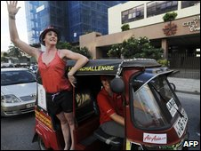 Tourists take part in the Sri Lanka tuk-tuk race reach the finish line in Colombo on 14 September 2009