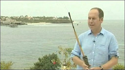 Rory Cellan-Jones holding broadband cable in Mombasa
