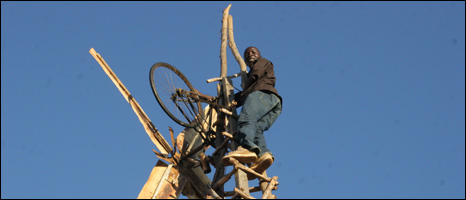 William Kamkwamba up one of his windmills