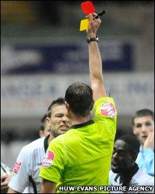Gorka Pintado is shown a red card by referee James Linington
