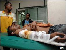 A man injured in the quake waits for treatment at a Denpasar hospital