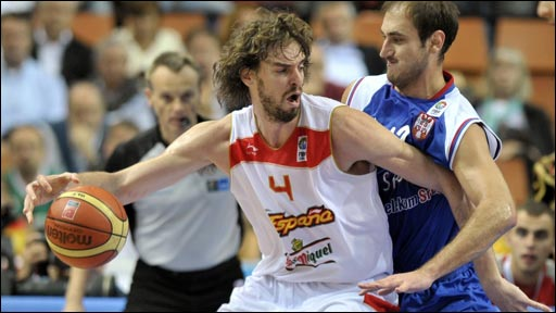 "Spain""s Pau Gasol (L) is blocked by Serbia""s Nenad Krstic"