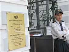 Vietnamese guard stands at the entrance to the Danish Embassy in Hanoi. Photo: 24 September 2009