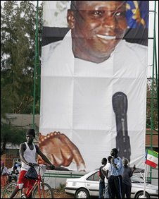 A poster depicting President Jammeh in a street scene