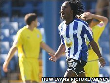Etienne Esajas celebrates as Cardiff's misery at Hillsborough continues